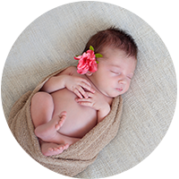 newborn girl with fresh flower