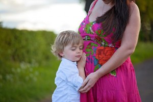 little boy with pregnant mum