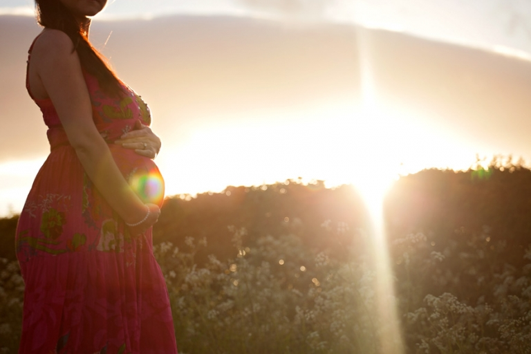sunset photo of pregnant woman