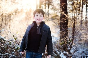 little boy in the snowy forest inFife