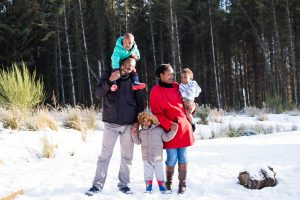 family with small children on the snow