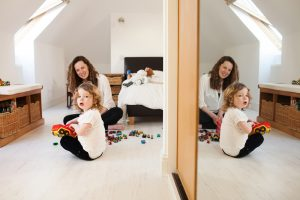 mum playing with her toddler in his bedroom