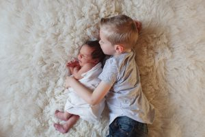 newborn baby with 4 years old brother