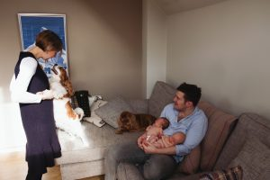 family with newborns and dogs at home
