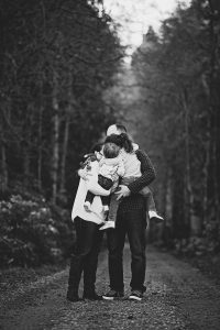 black and white photos of a family hugging tight