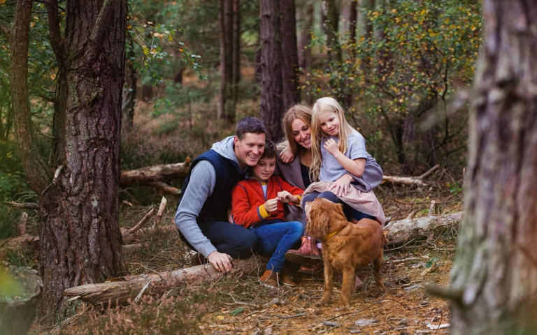 beautiful family in the forest in Scotland
