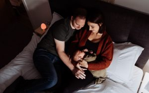 Parents iwht a newborn baby in their bedroom