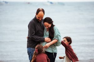 maternity client with her family on the beach in Scotland