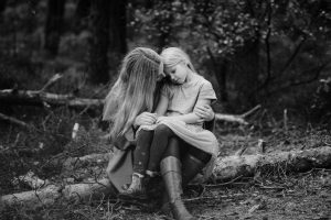 black and white photo of a beautiful mum in the forest with her daughter