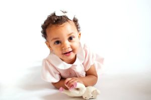 sweet baby girl on white backdrop